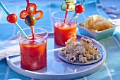 Gazpacho with peppers in glasses with straws