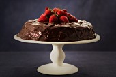 Chocolate cake with a fresh strawberry top