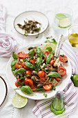 Tomato salad with giant capers and basil