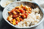 Vegan curry with chickpeas and tofu, served with brown rice
