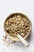 Muesli ingredients: dried apple cubes, sunflower seeds, oat flakes, cold pressed coconut butter, spices