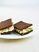 A pumpernickel sandwich with cottage cheese