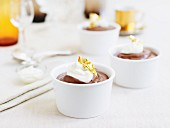 Chocolate cream pudding with sour cream and gold leaf
