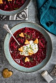 Russian Borscht beetroot soup with sour cream, dill and puff pastry croutons