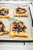 Pastries with caramelised onions, cheese and mushrooms