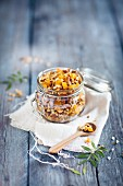 Homemade crunchy muesli with orange and dried apricot