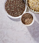 Linseed, quinoa, lentils and barley in bowls