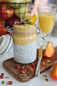 Vanilla and coconut chia pudding. Yellow layer consists of bananas and mango