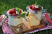 lemon and vanilla mascarpone cheese in a jar with strawberries and cookies