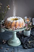 Gugelhupf with icing sugar and flowers