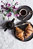 Croissants, coffee and flowers