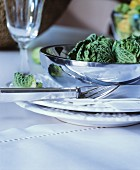 Place setting with shiny bowl on white table mat