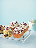 Mini Orange, coconut and cranberry loaves with coconut frosting
