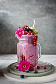 Berry milkshake made with vanilla gelato and red fruit with cream and red fruit compot