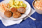 Turkey meatballs with potatoes and carrot leek salad