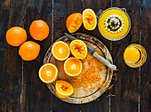 Fresh oranges - some squeezed to make fresh orange juice