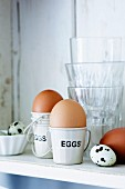 Eggs in egg-cups, with quails eggs