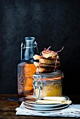 Duck liver in a glass jar with toasted bread slices and a flask of Sauternes wine