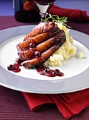 Roast duck with mashed potato and blackcurrant jus