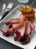 Roast duck with rosti potatoes and blackcurrant jus
