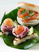 Smoked salmon roll with melon and parma ham canapes