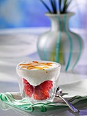 A glass of berry brulee dessert