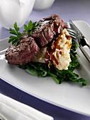 A plate of skirlie, mashed oats and fillet steak