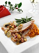 Roast turkey slices with stuffing and carrot puree