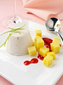 Lime and coconut panna cotta with raspberry coulis and mango pieces lactose and gluten freee