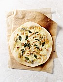A thin-crust pizza bianca with gorgonzola, mozzarella and walnuts