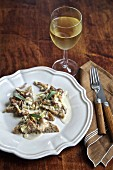 Sautéed wild mushrooms on bread with white wine