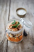 Couscous salad with chicken in a glass jar with lid