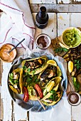 Taco shells with fried aubergines and houmous