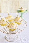 Lemon and vanilla cupcakes on a cake stand