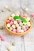 Small colourful gnocchi with basil leaves