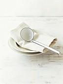 A soup ladle on a plate