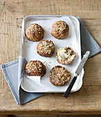Muesli bread rolls with butter