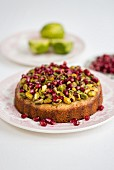 Pistachio lime pomegranate syrup cake
