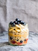 Breakfast quinoa with fresh fruit, fruit mousse and peanut butter