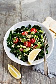 Kale salad with quinoa and cherry tomatoes