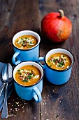 Pumpkin soup with pecan nuts, sesame seeds and almonds