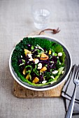 Red cabbage and savoy cabbage salad with orange and cashew nuts