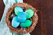 Dyed Easter eggs with batik patterns in a basket