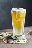 Beer lemonade with a slice of lemon