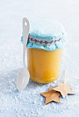 Lemon curd in a glass jar as a gift