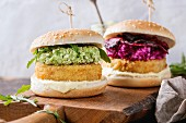 Two vegetarian hamburgers with onion and cheese cutlets, avocado salad, arugula, fried beetroot and yogurt sauce