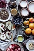 Homemade muesli breakfast with honey, greek yoghurt, and fruits