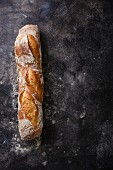 Fresh Baguette bread on dark background copy space