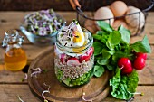 Buckwheat salad with egg and radish in a jar