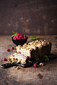 Coffee cake with raspberries and walnuts.
